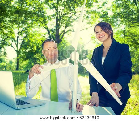 Environmentalist Business People with Wind Turbine in Green Forest