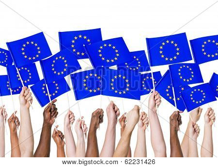 Diverse Hands Holding European Union Flags