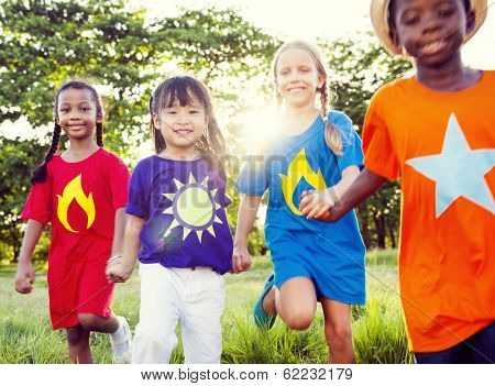 Friendship: Diverse Children Playing Super Heroes in Park