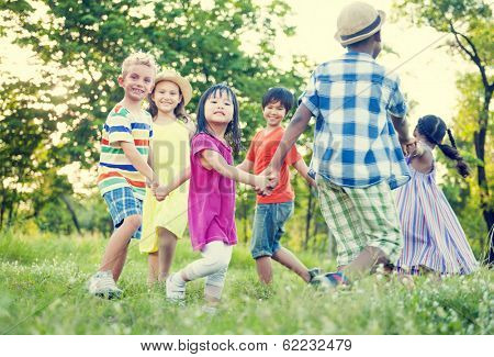 Diverse Children Holding Hands and Dancing in The Park