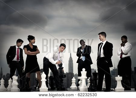 Making The Next Move: Business People Playing Chess