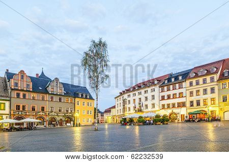 People Enjoy Sunset At Central Market Place In Weimar