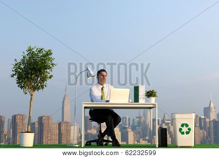 Environmentalist Businessman in Outdoor Green Office at NYC Skyline