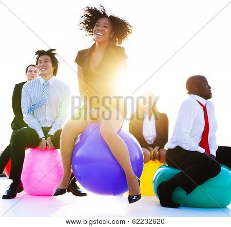 Business People Jumping on Bouncy Balls