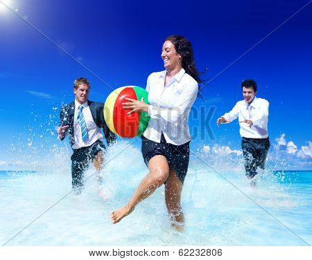 Business People Playing Ball on at a Beach