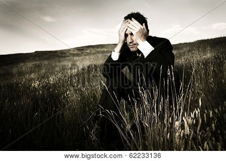 Lonely and Depressed Businessman On a Field