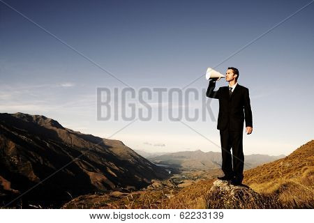 Businessman Shouting On The Top of a Mountain, New Zealand