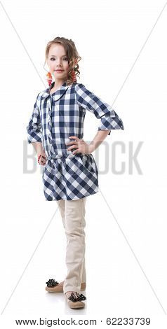 Cute little fashionista posing in checkered tunic