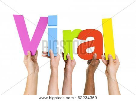 Multi-Ethnic Group of Diverse People Holding Letters To Form The Word Viral