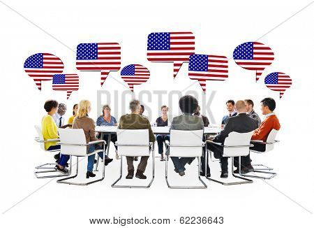 Multi-Ethnic People in a Business Meeting With Flag of United States