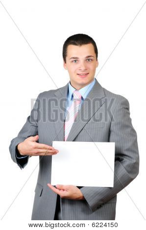 Portrait of a young man holding a blank banner isolated on white