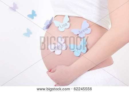 Pregnant Woman's Belly With Colorful Butterflies With Female Names