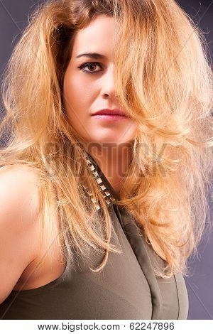 Portrait of a blonde busty woman