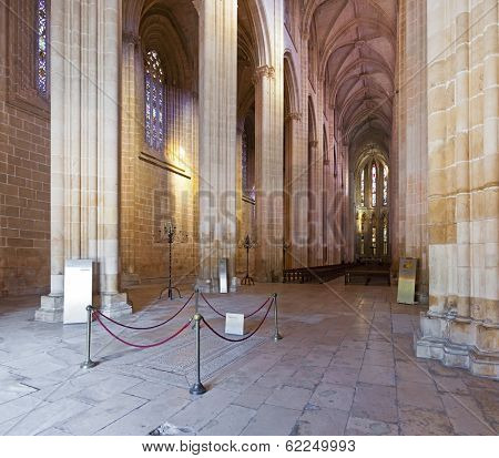 Batalha, Portugal - March 02, 2013: Batalha Monastery. Nave and Altar of the Church. Gothic and Manueline masterpiece. Portugal. UNESCO World Heritage Site.