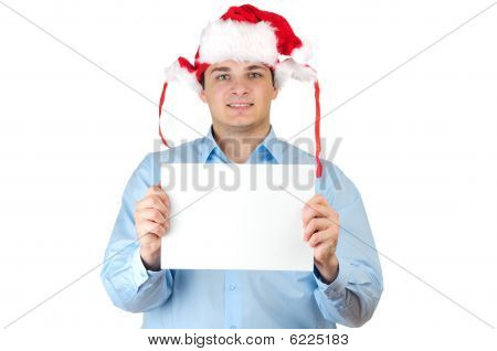 Young man in santa's hat holding empty blank card isolated on white