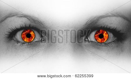 Detail View Of Female Eyes With Flames