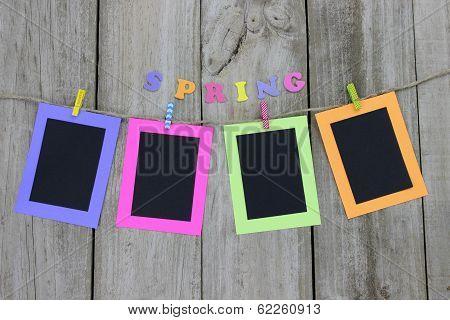 Colorful frames hanging on clothesline