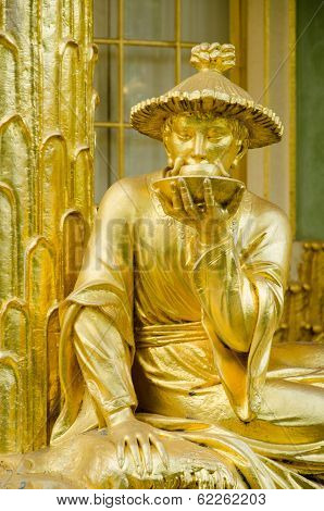 Golden Statue In Front The Chinese House, Sanssouci. Potsdam. Germany