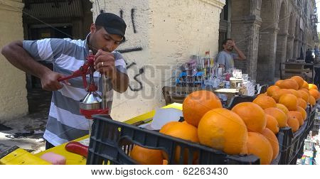 Young Iraqi man sells orange juice