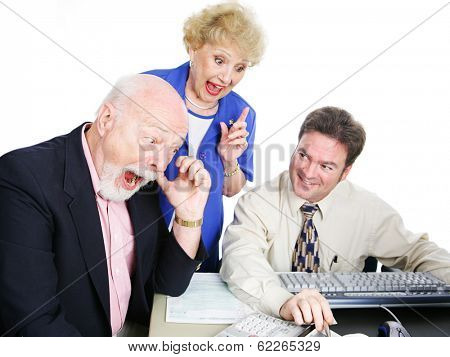 Seniors with their accountant, excited about getting a big tax refund.  White background