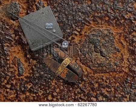 old working rusty plate with diamonds, anvil and jewelery vise