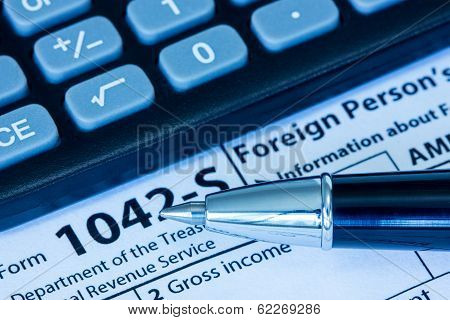 Us Tax Form With Pen And Calculator