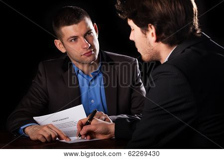 Man Signing A Loan With A Lawyaer