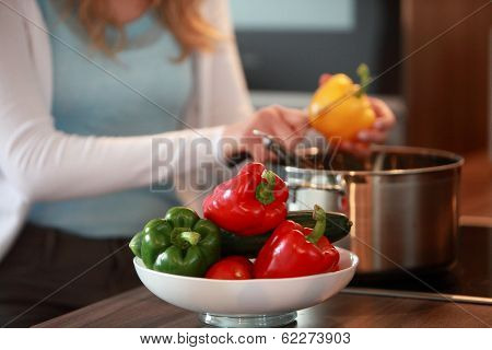 Housewife Cutting Fresh Bell Peppers