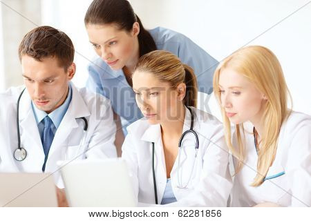 healthcare, medical and technology concept - ggroup of doctors with laptop and tablet pc computer in hospital