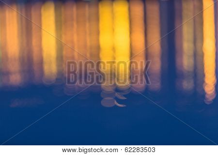 abstract background of the defocused traffic lights in the water.