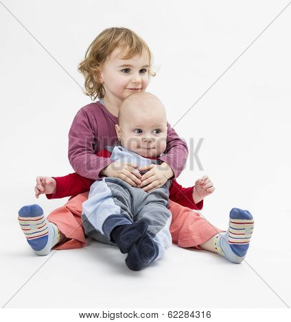 Siblings Isolated In Light Background