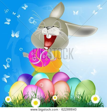Happy Rabbit with Easter Eggs on the green grass.Holiday