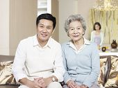 stock photo of mother law  - home portrait of asian mother and son - JPG