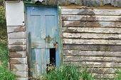foto of wooden shack  - Wooden hut with weathered wooden broken door - JPG