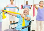 stock photo of panic  - Mature Adults and a Disabled Person Exercising in a Gym - JPG