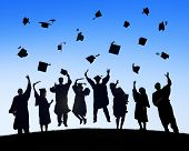 stock photo of graduation gown  - Group Of Students Celebrating Graduation and Throwing Caps - JPG