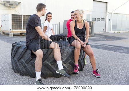 Smiling fitness team taking a break