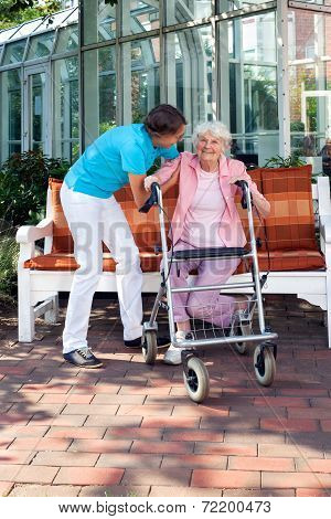 Senior Woman Being Helped By A Care Assistant