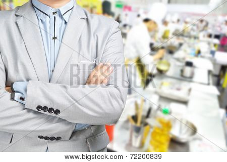 Business Man Standing Against The Background Of Kitchen