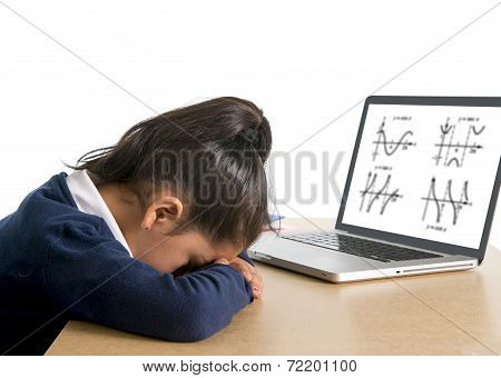 Little Schoolgirl Bored And Tired With Computer Maths Homework