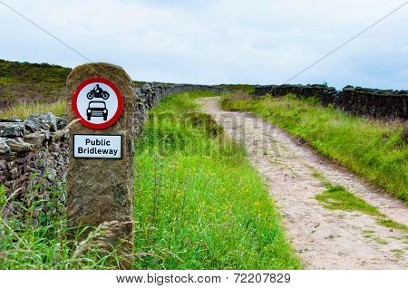 Public Bridleway Red And White Sign Post In English Countryside