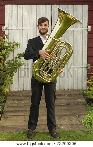 Male Musician Smiling With Tuba