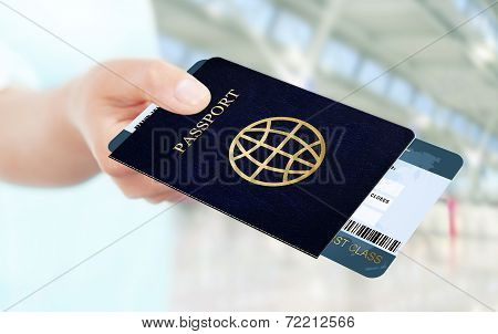 Hand Holding Air Ticket And Passport On Airport