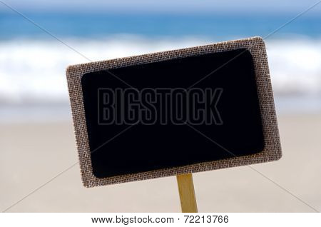 Nameplate On The Sandy Beach