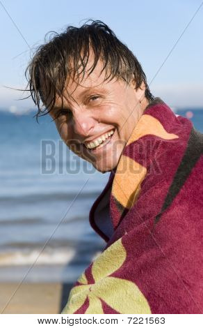 happy smiling forties man on beach