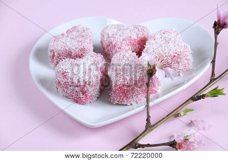 Homemade Australian Style Pink Heart Shape Small Lamington Cake On Heart Shape White Plate With Spri