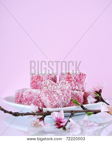Homemade Australian Style Pink Heart Shape Small Lamington Cakes With Spring Blossom On A Reflective