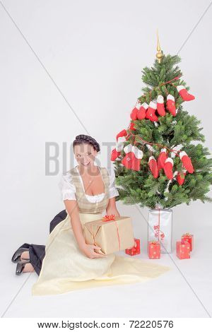 Woman in Dirndl pleased with gift