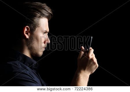Obsessed Andry Teenager Texting On The Phone In Black