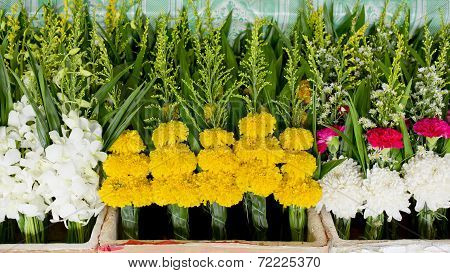 Bunch Of Local Marigold At Market In Thailand  For Buddha. Handful Of Marigold Background Texture.